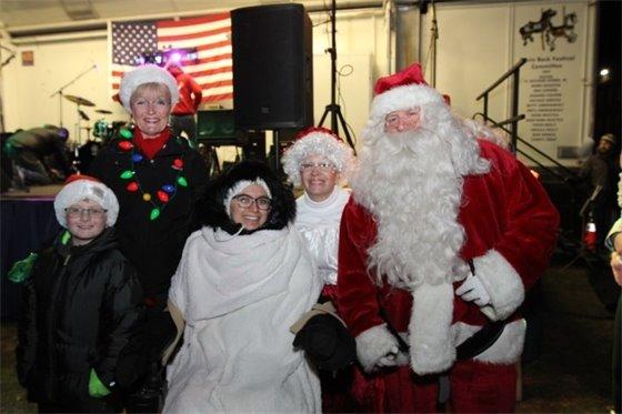 Gabby Murillo helps Rossi light Christmas tree on Green