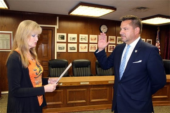 Collins sworn in to police commission for 3rd term